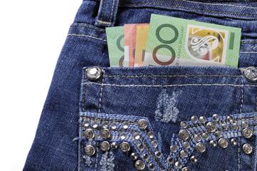 Australian money in back pocket of ladies jeans