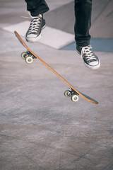 Legs in sneakers on a skateboard