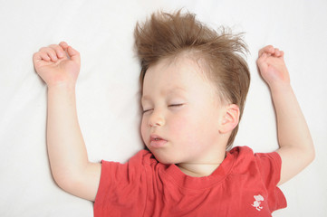 Kid sleeping arms outstretched