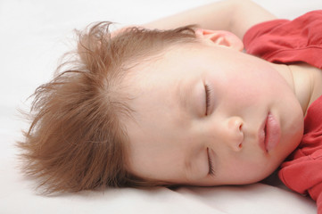 European kid sleeping 3 years old portrait