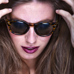 Fashion portrait of young and stylish woman