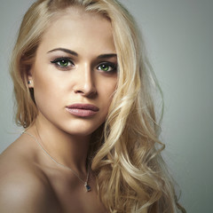 young woman.beautiful blond girl with green eyes.skin care
