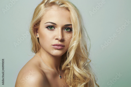 young woman.beautiful blond girl.Curly hair.toned