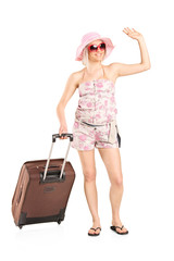 Female tourist carrying her luggage