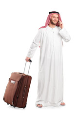 Sheik talking on phone and carrying a luggage