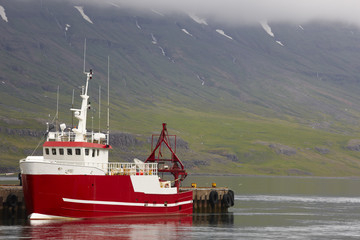 Iceland. Seydisfjordur. Dock with fishing boat.