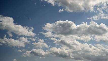 Moving clouds on blue sky.