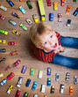 Leinwanddruck Bild - Boy with his toy car collection