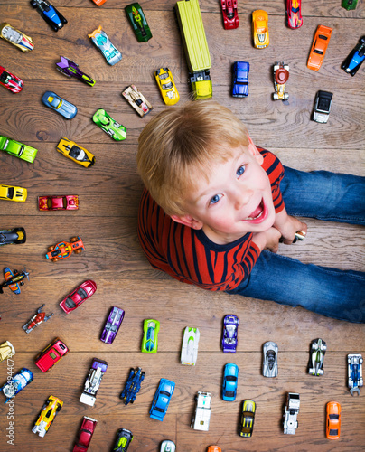 Leinwanddruck Bild Boy with his toy car collection
