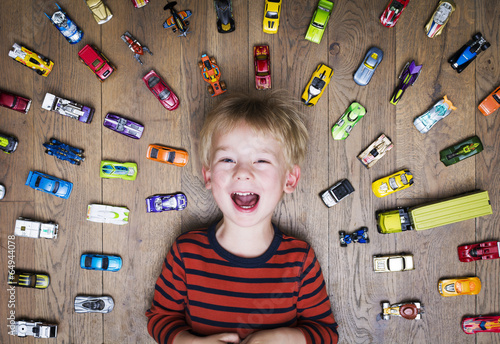Leinwandbild Motiv Boy with his toy car collection