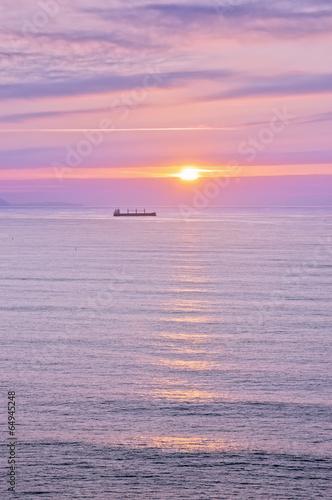 beautiful sunset with last sun rays on sea