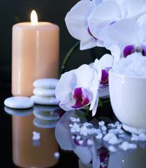 sea salt with candle and orchid