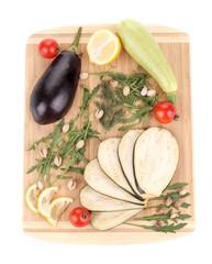 Vegetables on wooden board.