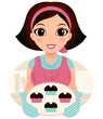 Young baking woman holding cookies