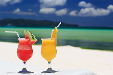 fruit cocktails on tropical beach