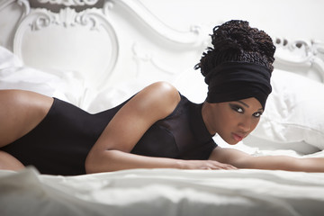 Model lying on a bed and posing