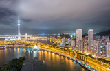 Macau, China. Aerial view of city buildings and tower at night