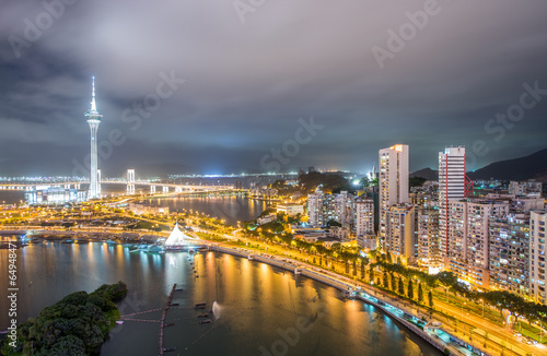 Macau, China. Aerial view of city buildings and tower at night - 64948471