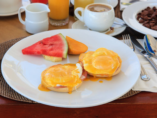 breakfast with eggs benedict  and coffee