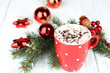 Hot chocolate with cream in color mug,