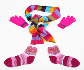 Winter scarf, gloves and socks, isolated on white