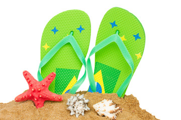 blue sandals and starfish in sand