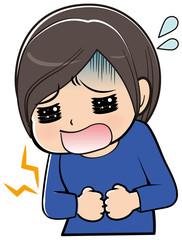 腹痛に悩む女性
