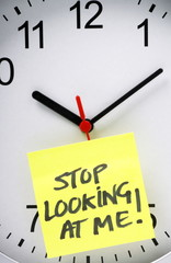 Stop Looking at The Clock concept with a wall clock