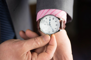 Man business modern in wristwatch