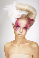 Faceart. Blonde with Skin Colored Pink, False Lashes and Feather