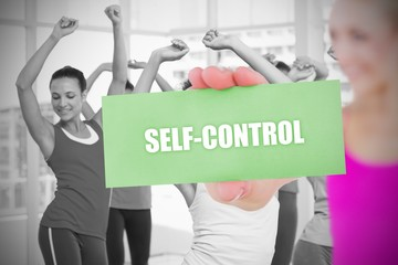 Fit blonde holding card saying self control