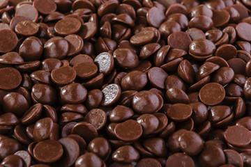 chocolate drops on a white background