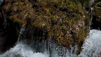 water flowing in the stream on cascade waterfall