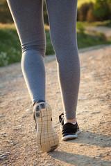 detail of woman legs walking on the field
