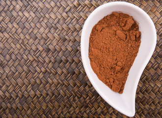 Cocoa powder for making drinks in a white ceramic