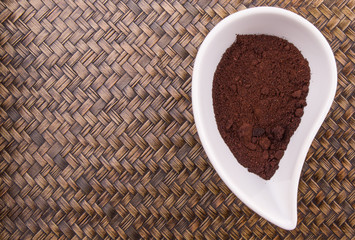 Ground coffee powder in ceramic container