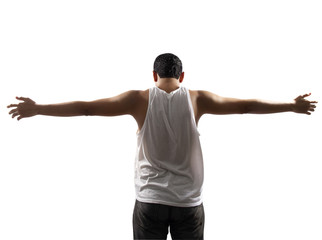 Rear view of young man with his arms stretched out isolated on w