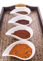 Cocoa powder, dried tea leaves and grounded coffee