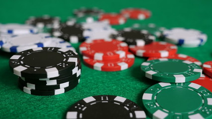 Falling Poker Chips on a Game Table (Slow Pan)