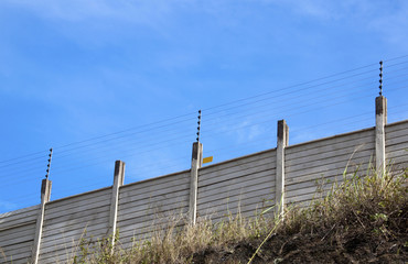Electric Security Fence Atop a Precast Wall
