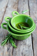 fresh rosemary bunch in bowl with olive oil