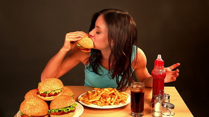 Woman eating fast food.Time lapse.