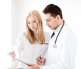 two doctors writing prescription
