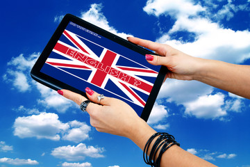 woman hands holding tablet with english language sign