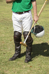 Male polo player holding polo mallet