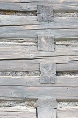 Wooden wall of log cabin