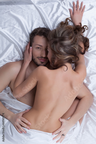 Top view of satisfied lovers caress each other