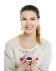 happy girl with piggy bank
