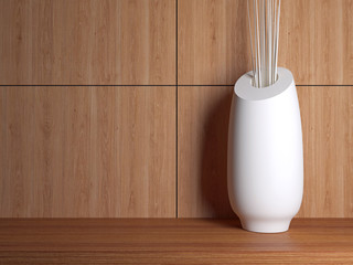Vase on the wooden shelf.