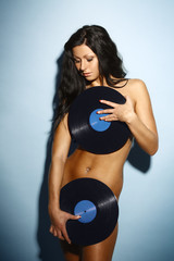 Beautiful brunette topless in a panties, with the vinyl record